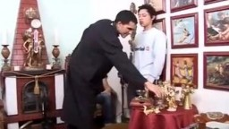 latino priest with alter boy